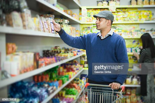 Asian young man shopping at supermarket.