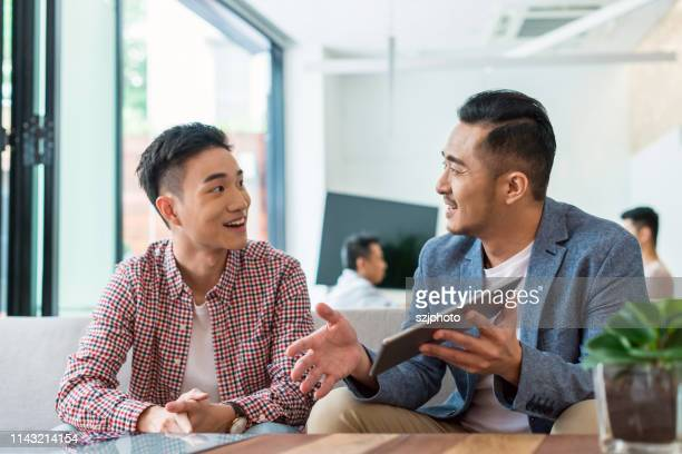 asian young people talking about business - asia stock pictures, royalty-free photos & images