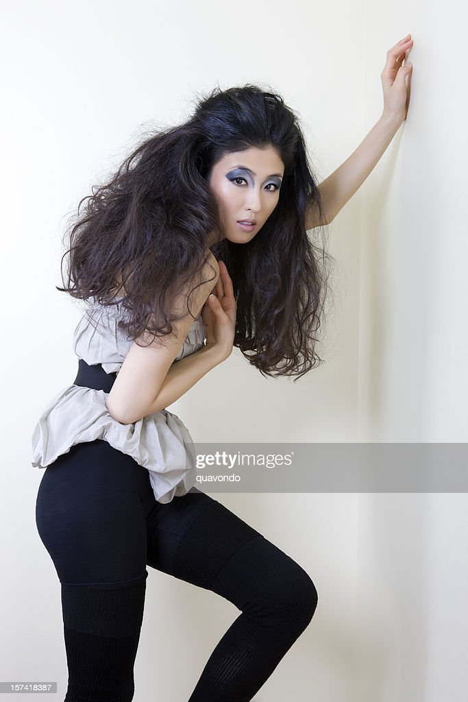 Asian Young Woman Fashion Model Posing in Big Hair, Copyspace : Stock Photo