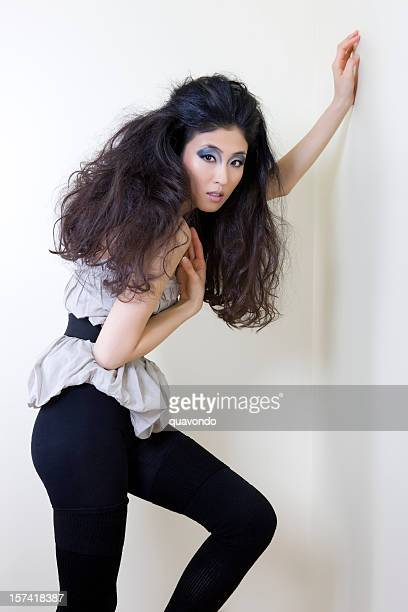Asian Young Woman Fashion Model Posing in Big Hair, Copyspace