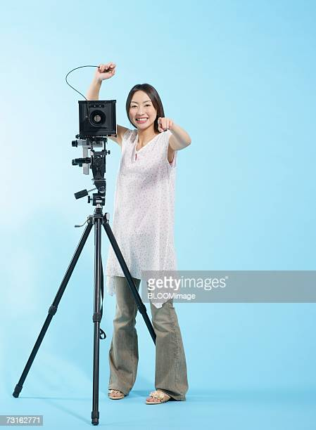 Asian young woman photographing