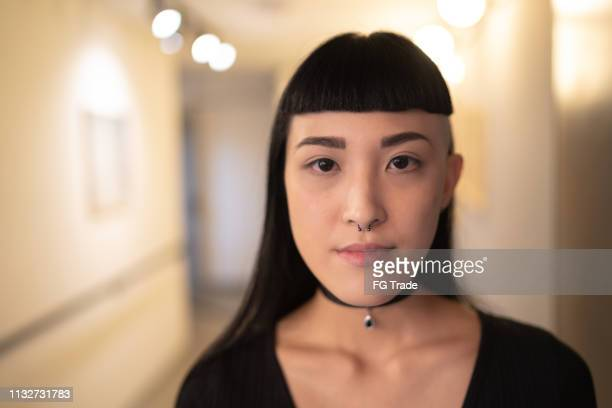 asian young woman portrait looking at camera - piercing stock photos and pictures
