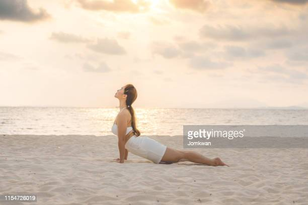 asian young woman practice cobra pose