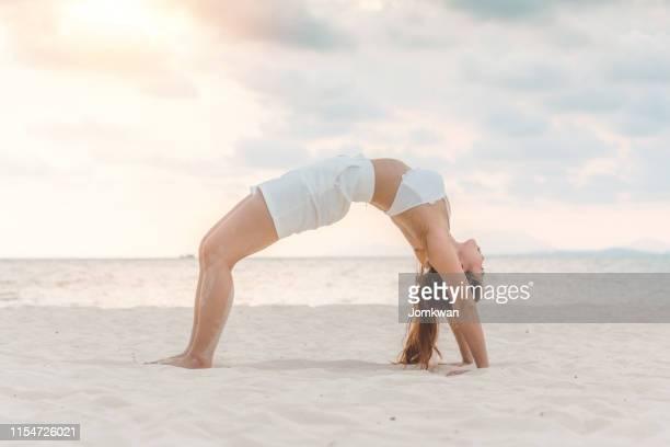 asian young woman practice yoga bridge