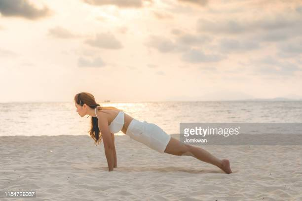 asian young woman practice yoga plank