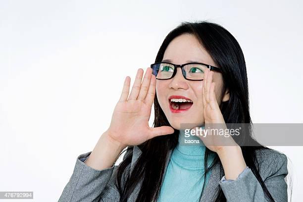 Asian young woman shouting