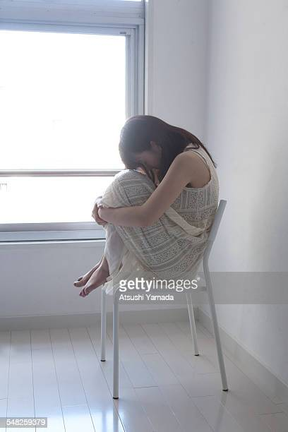 Asian young woman sitting on chair