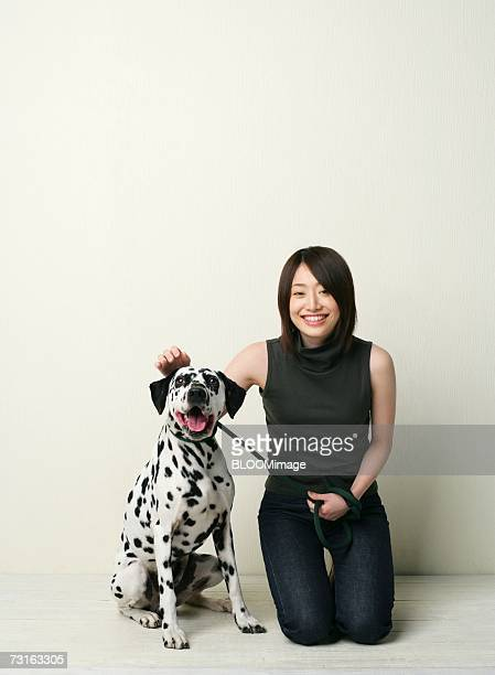 Asian young woman smiling with dog