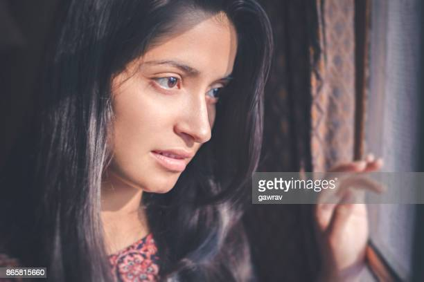asian young woman standing near door and looking at view. - black hair stock pictures, royalty-free photos & images