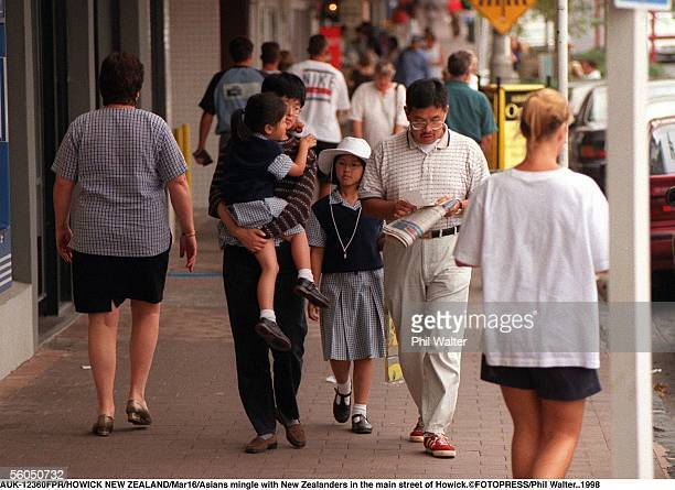 Asians mingle with New Zealanders in the main street of Howick