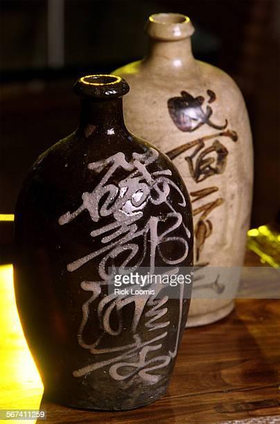 LSasianthemejars0313RL––Balboa Island––Antique saki jars adorn a table top in the Asian–themed living room of Dana Eggerts home on Balboa Island