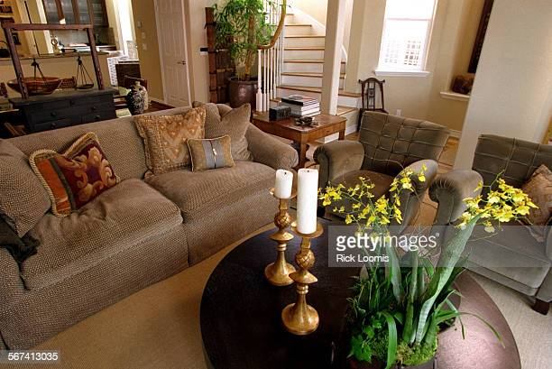 LSasianthemeroom0313RL––Balboa Island––The Asian–themed living room of Dana Eggerts home on Balboa Island with raisin–stained kettle table in the...