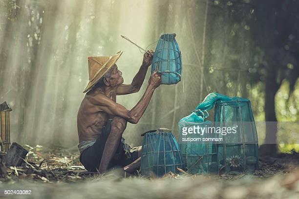 Asia,Old fisherman living Mekong.