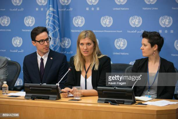 AsiaPacific Director Tim Wright left and ICAN Steering Group member Ray Acheson right look on as ICAN Executive Director Beatrice Fihn speaks during...