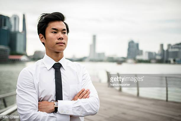 Asiatic Businessmen standing in Singapore