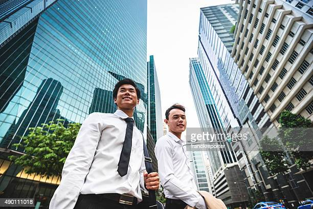 Asiatic Businessmen waiting the taxi in singapore