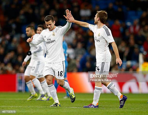 Asier Illarramendi and Nacho Fernandez of Real Madrid celebrate after scoring during the Copa del Rey round of 32 match between Real Madrid and...