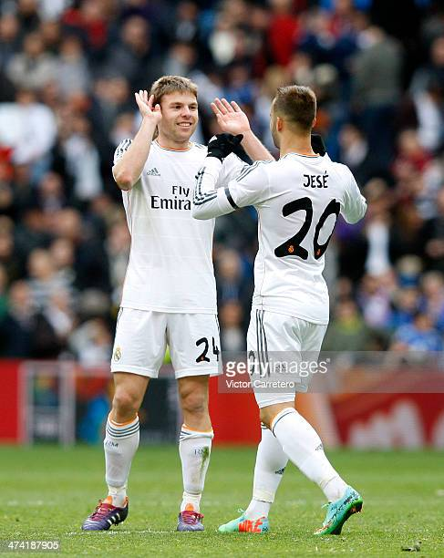 Asier Illarramendi of Real Madrid celebrates with his teammate Jese Rodriguez after scoring the opening goal during the La Liga match between Real...