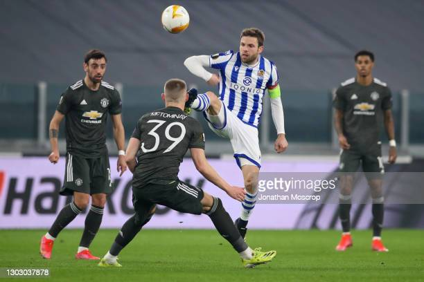 Asier Illarramendi of Real Sociedad chips the ball over the head of Scott McTominay of Manchester United as Bruno Fernandes and Marcus Rashford of...