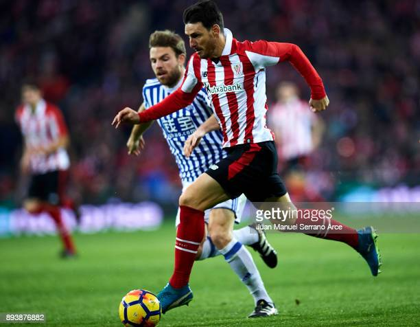 Asier Illarramendi of Real Sociedad competes for the ball with Aritz Aduriz of Athletic Club during the La Liga match between Athletic Club Bilbao...