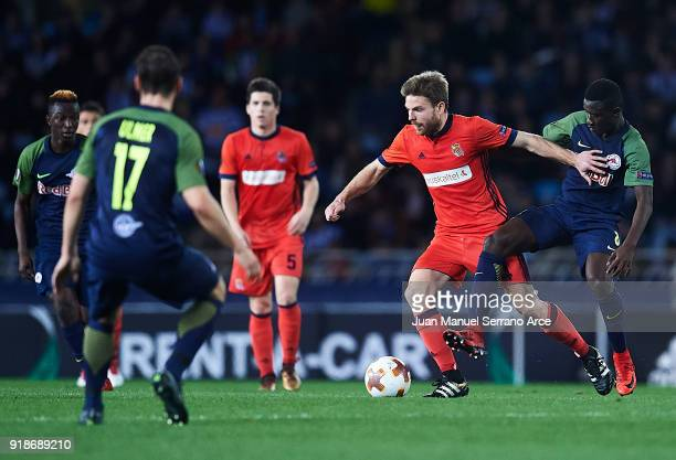 Asier Illarramendi of Real Sociedad competes for the ball with Diadie Samassekou of FC Red Bull Salzburg during UEFA Europa League Round of 32 match...