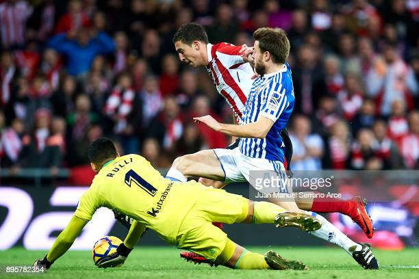 Asier Illarramendi of Real Sociedad competes for the ball with Oscar De Marcos of Athletic Club during the La Liga match between Athletic Club Bilbao...