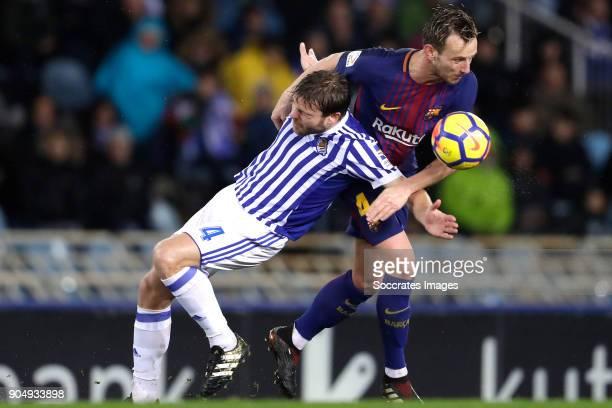 Asier Illarramendi of Real Sociedad Ivan Rakitic of FC Barcelona during the La Liga Santander match between Real Sociedad v FC Barcelona at the...