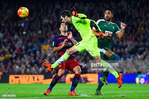 Asier Riesgo of SD Eibar clears the ball under pressure from Luis Suarez of FC Barcelona during the La Liga match between FC Barcelona and SD Eibar...
