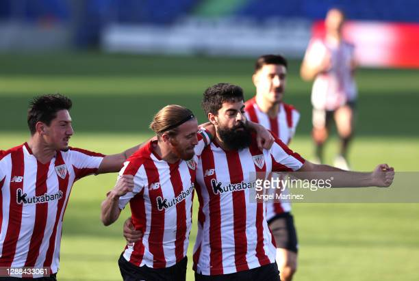 Asier Villalibre of Athletic Bilbao celebrates with team mate Iker Muniain after scoring their sides first goal during the La Liga Santander match...