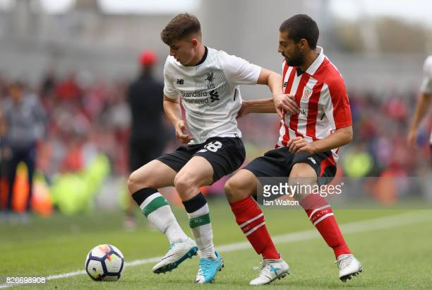 Asier Villalibre of Athletic Club and Ben Woodburn of Liverpool battle for possession during the Pre Season Friendly match between Liverpool and...