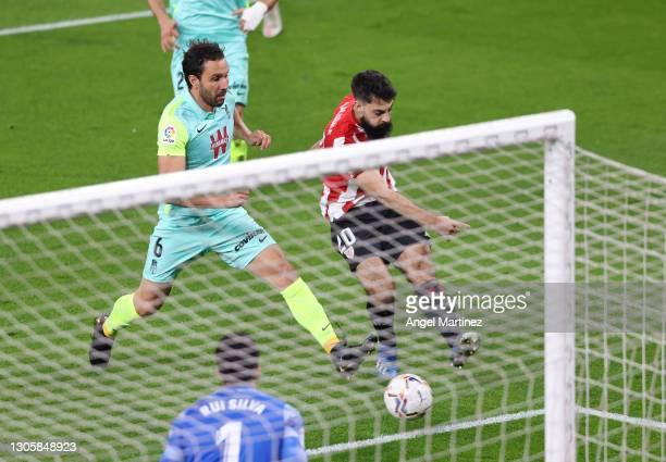 Asier Villalibre of Athletic Club scores their sides first goal past Rui SIlva of Granada CF during the La Liga Santander match between Athletic Club...