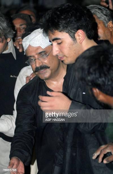 Asif Ali Zardari husband of former Pakistani premier Benazir Bhutto comforts his son Bilawal after her funeral prayers at Ghari Khuda Baksh, 28...