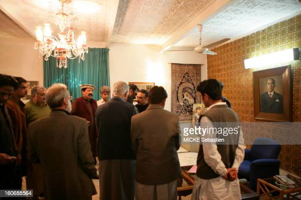 Asif Ali Zardari posing in a living room of the PPP in Larkana, surrounded by party members, four days after the death of his wife Benazir Bhutto.