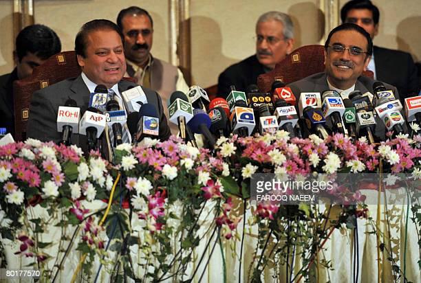 Asif Ali Zardari widower of slain former premier Benazir Bhutto and Pakistani former premier Nawaz Sharif address a press conference in Murree some...