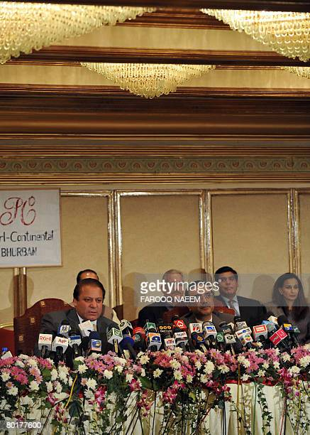 Asif Ali Zardari widower of slain former premier Benazir Bhutto and Pakistani former premier Nawaz Sharif address a press conference in Murree some...