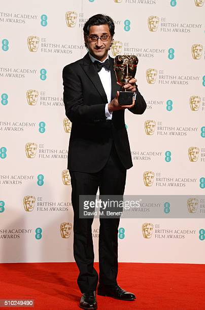 Asif Kapadia winner of Best Documentary for 'Amy' poses in the winners room at the EE British Academy Film Awards at The Royal Opera House on...