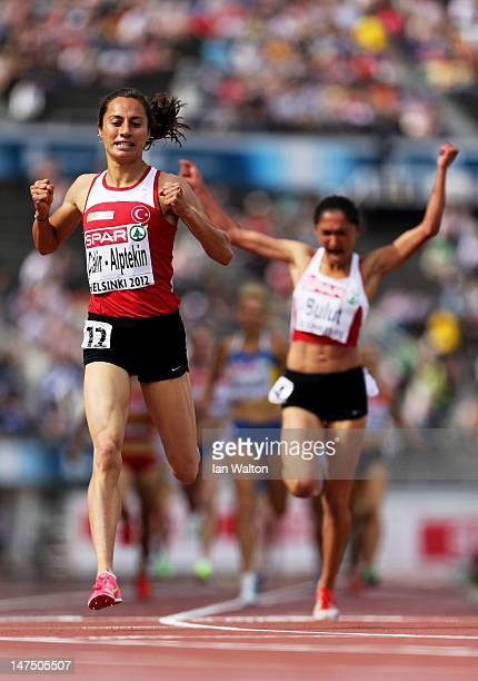 Asil CakirAlptekin of Turkey crosses the line ahead of Gamze Bulut of Turkey to win the Women's 1500 Metres Final during day five of the 21st...