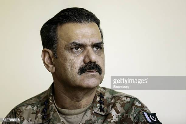 Asim Bajwa lieutenant general and directorgeneral of the InterServices Public Relations the media wing of the Pakistan Armed Forces listens during an...