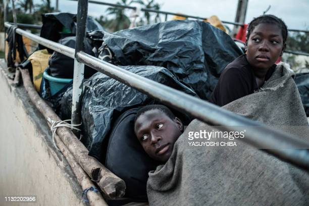 Asimane Jorge Manjara and Marta Alexandre Goncalves wake up as they stay in shelter at the stands of Ring ground in Buzi Mozambique on March 23 2019...