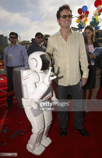 """Asimo and Greg Kinnear during Honda's """"Asimo"""" Robot Walks the Red Carpet at the Premiere of """"Robots"""" at Mann Village Theater in Westwood, California,..."""