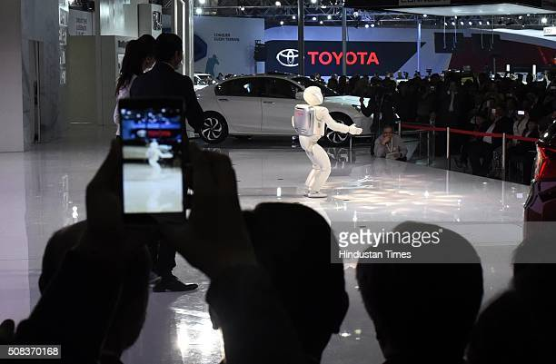 Asimo humanoid robot designed and developed by Honda performs at Honda Pavilion at the Auto Expo 2016 on February 4 2016 in Greater Noida India