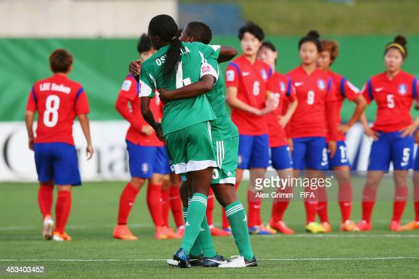 Asisat Oshoala and Ugo Njoku of Nigeria celebrate after the FIFA U20 Women's World Cup Canada 2014 group C match between Korea Republic and Nigeria...