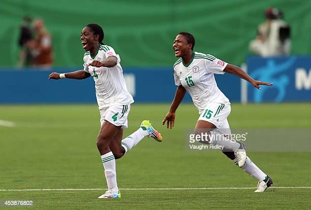 Asisat Oshoala and Ugo Njoku of Nigeria celebrate victory following the final whistle of the FIFA U20 Women's World Cup Canada 2014 Semi Final match...