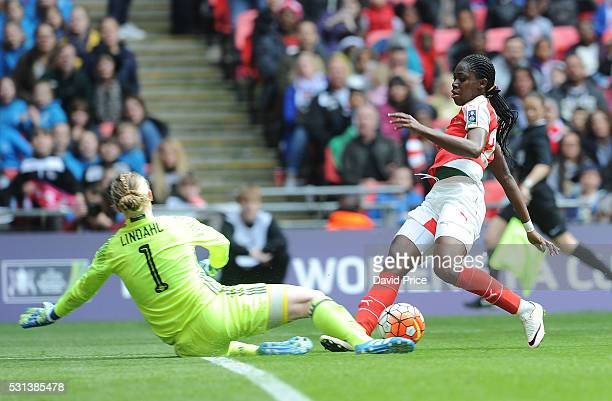 Asisat Oshoala of Arsenal Ladies challenges Hedvig Lindahl of Chelsea Ladies during the match between Arsenal Ladies and Chelsea Ladies at Wembley...