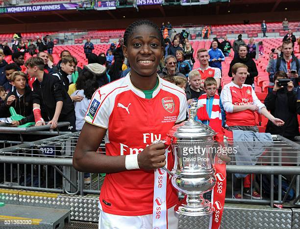 Asisat Oshoala of Arsenal Ladies lifts the FA Cup Trophy the match between Arsenal Ladies and Chelsea Ladies at Wembley Stadium on May 14 2016 in...
