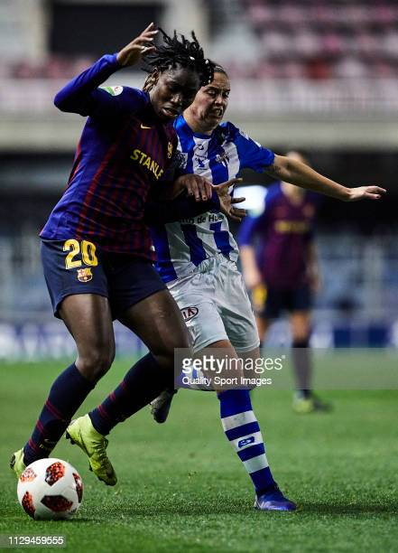 Asisat Oshoala of FC Barcelona competes for the ball with Flor Bosegundo of Sporting Huelva during the Liga Iberdrola match at Mini Estadi on...