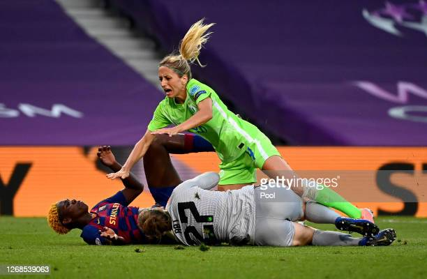 Asisat Oshoala of FC Barcelona, Kathrin-Julia Hendrich of Vfl Wolfsburg and Friederike Abt of Vfl Wolfsburg collide during the UEFA Women's Champions...