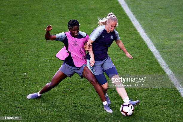 Asisat Oshoala of FC Barcelona Women and teammate Stefanie van der Gragt battle for the ball in a training session during previews ahead of the UEFA...