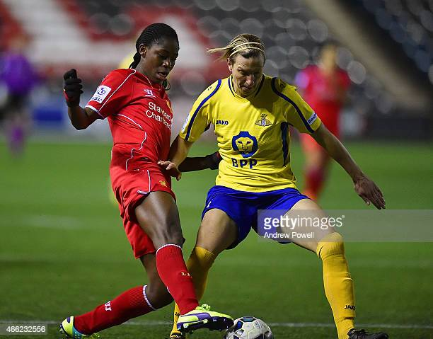 Asisat Oshoala of Liverpool competes with Leandra Little of Doncaster Rovers Ladies during a Pre Season friendly match between Liverpool Ladies and...