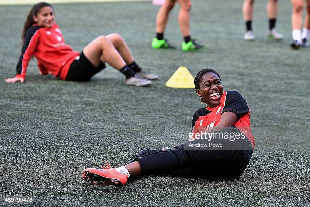 Asisat Oshoala of Liverpool Ladies laughs during a training session at Select Security Stadium on September 24 2015 in Widnes England